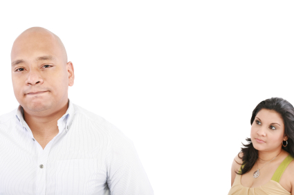 young couple on white background having a dispute. Focus on man